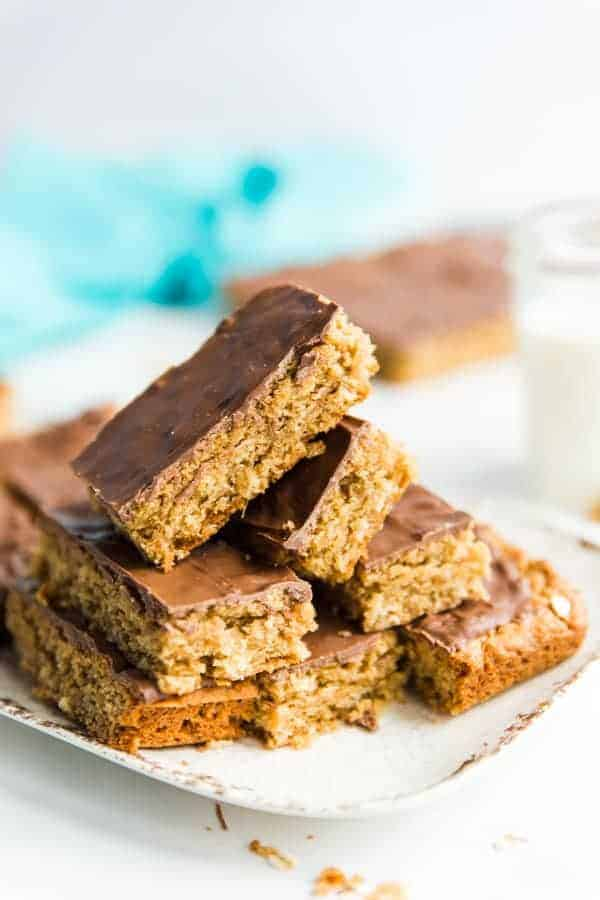 Chocolate Peanut Butter Oatmeal Cookie Bars stacked on a platter and ready to be eaten.