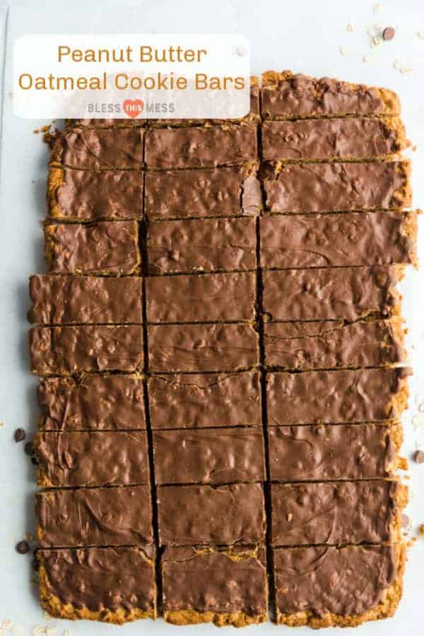 A pan of chocolate topped peanut butter oatmeal cookie bars cut into rectangular servings