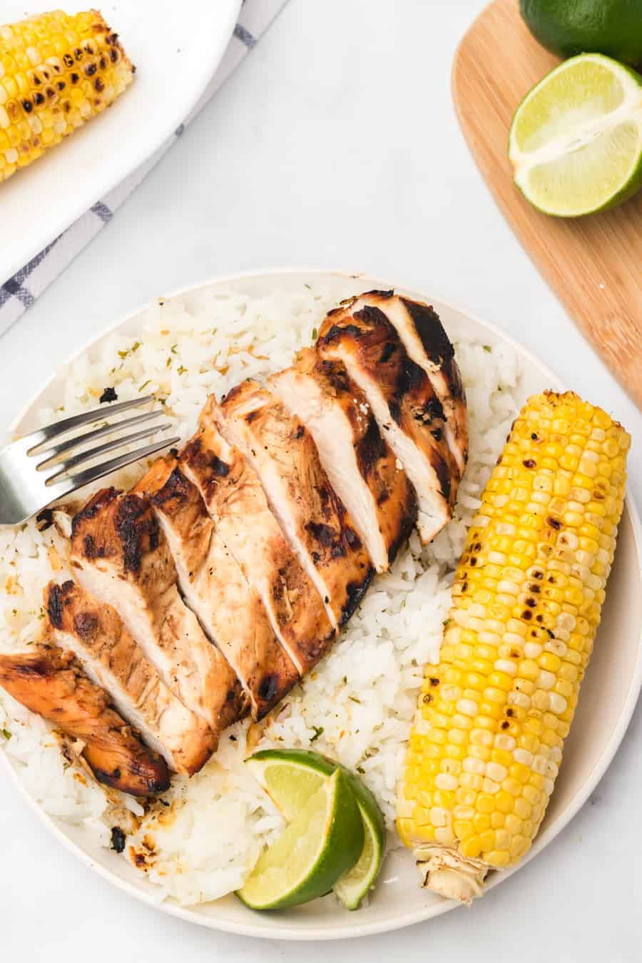 Grilled honey lime chicken breast is bright, sweet, and smoky, and is just as delicious on its own as a main dish as it is on top of salads, tacos, or anything else!