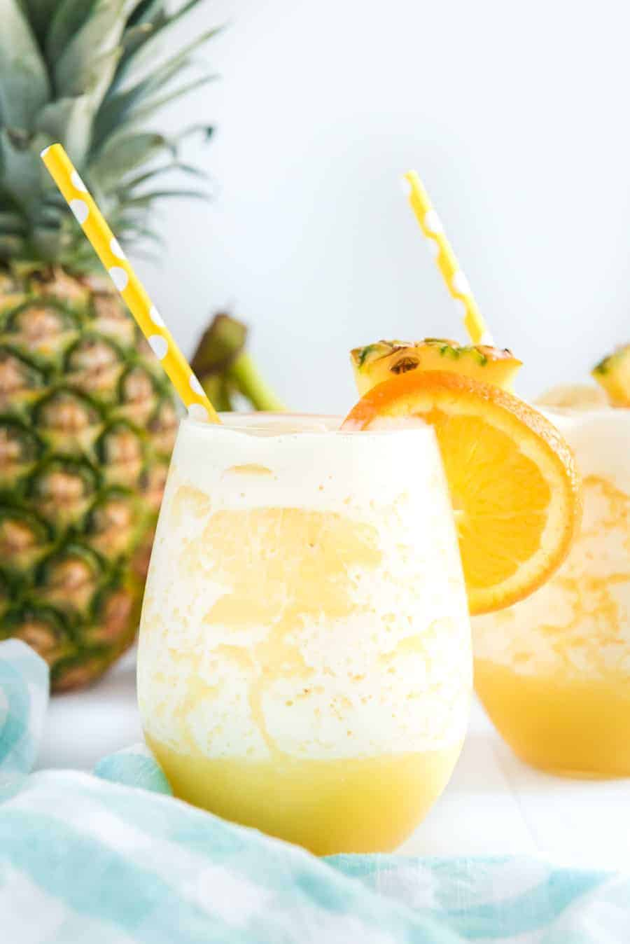You can't go wrong with the refreshing and tropical flavors of this orange pineapple banana smoothie! #smoothie #fruitsmoothie #tropicalsmoothie #orange #pineapple #banana