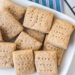 simple graham crackers on white dish and blue striped towel
