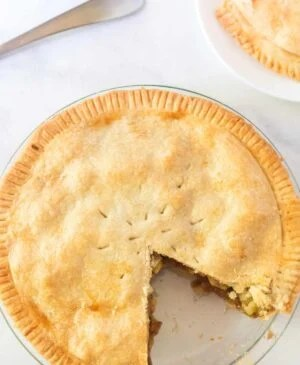 This Perfect Pie Crust (made with shortening and butter) comes together with just a few ingredients, one of which may just surprise you: vinegar.