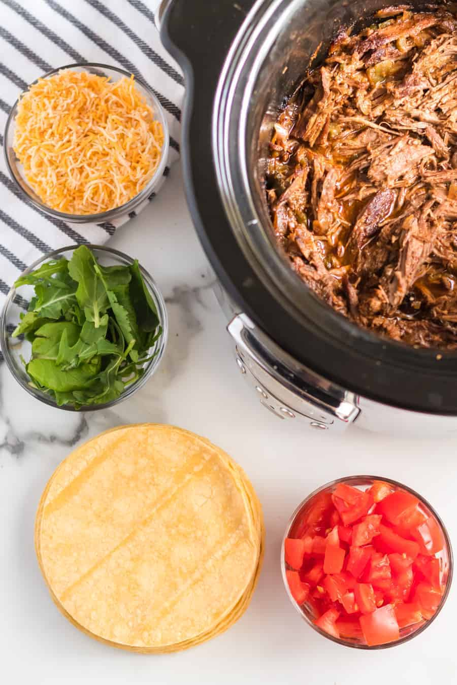 Smoky and hearty Steak Carnitas Meat in the Crock-Pot is one of the best set-it-and-forget-it meals that's exquisitely flavored and makes some tender and rich tacos.