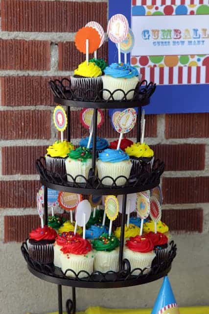 A cupcake tower with colorful circus-themed cupcakes