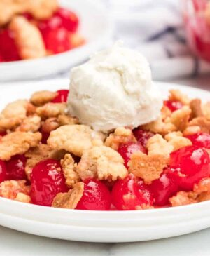 Sweet and tart with the perfect buttery, crumbly topping, homemade cherry crumble is an absolute game changer when it comes to festive and fun summertime dessert.