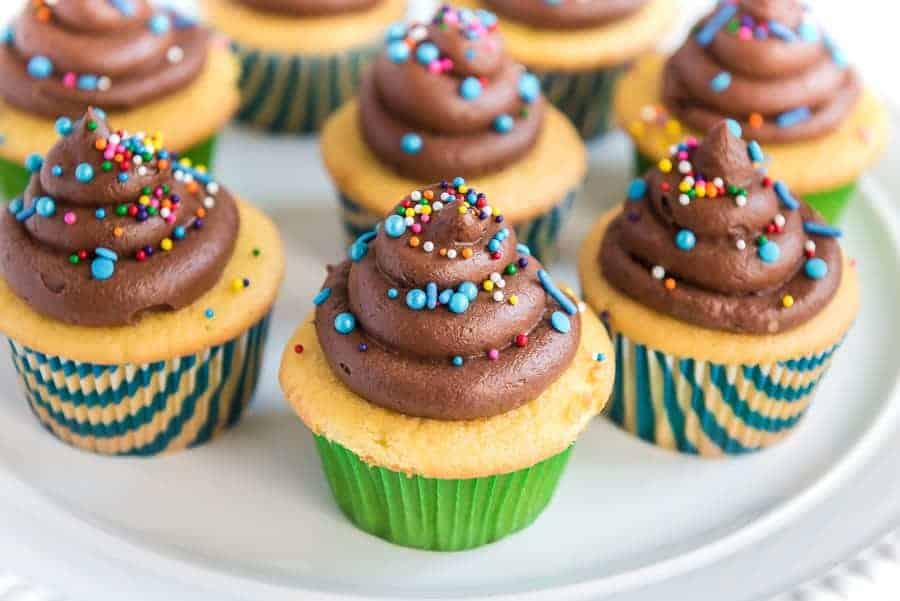 Homemade Chocolate Buttercream Frosting with sprinkles on cupcake