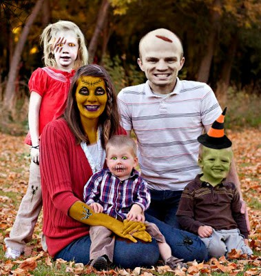A family of 5 outdoor photo with spooky Halloween face paint for everyone