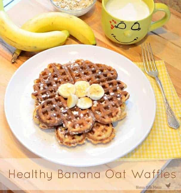 banana waffles on a plate with banana slices on top