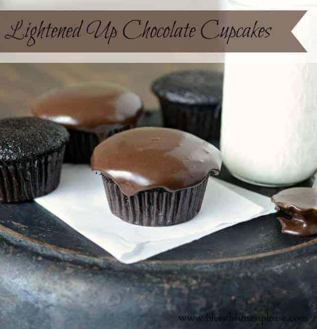 Fluffy Lightened Up Chocolate Cupcakes that save on calories but still taste amazing. Topped with low-fat chocolate icing, no one ever guesses they're healthy!
