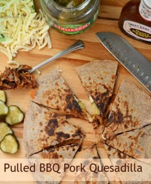 BBQ Pork Quesadillas are tender meat swimming in BBQ sauce is paired with melty cheese in between two tortillas. Throw on some chopped pickles and you are really in business.