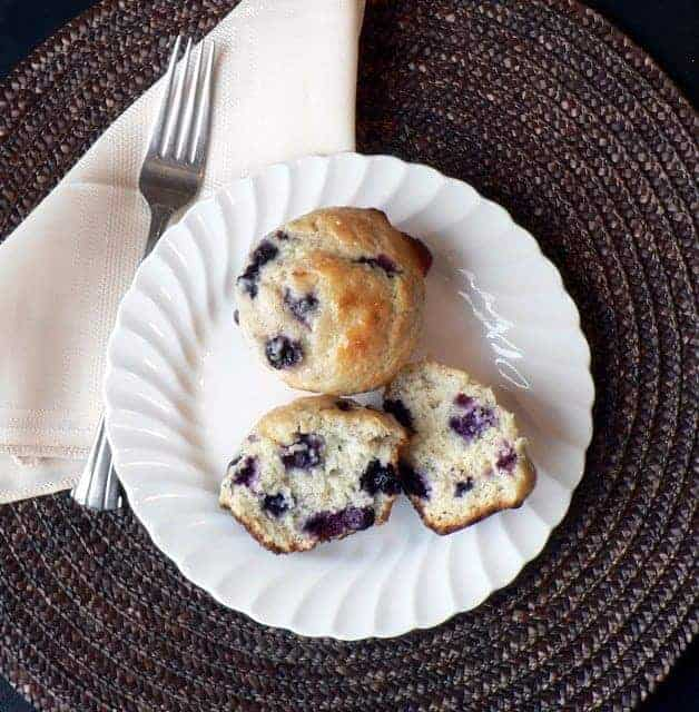 Blueberry lemon muffins on a white plate