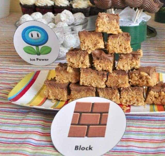 peanut butter bars on a colorful plate with a mario brick label