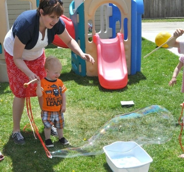 kids blowing giant bubbbles