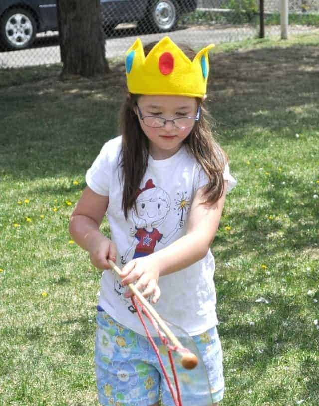 a girl wearing a felt peach's crown