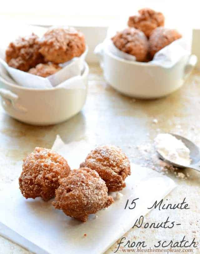 donut holes in a small dish sprinkled with powdered sugar