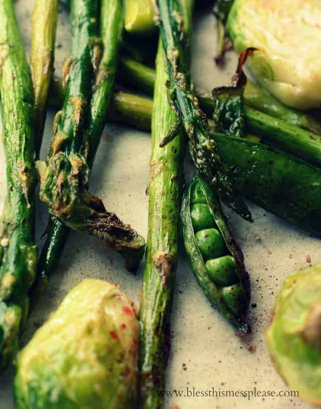 closeup shot of roasted vegetables with a pea split open