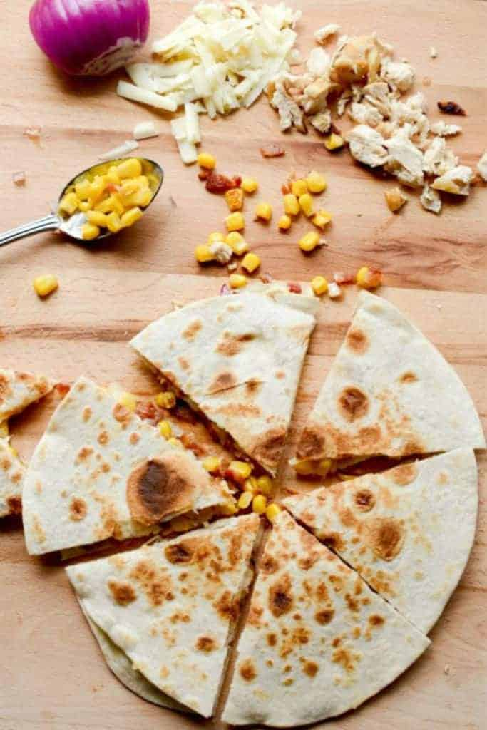 Bacon, Chicken and Sweet Corn Quesadilla with shredded chicken, red onion, shredded cheese and corn