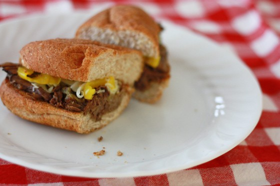 Peperoncini Beef Sandwiches cut in half on a plate