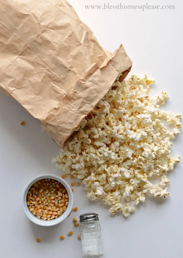 Quick and easy guide on how to pop popcorn in the microwave using just a paper bag, no oil needed.