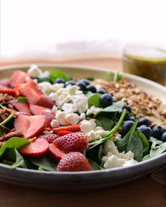 Berry Spinach Salad with Citrus Poppy Seed Dressing on a large plate