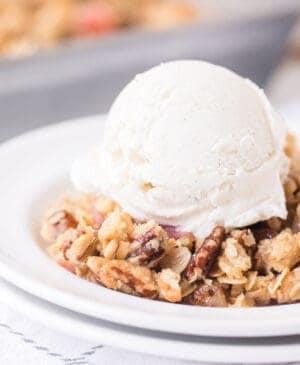 rhubarb crisp with scoop of vanilla ice cream and fork