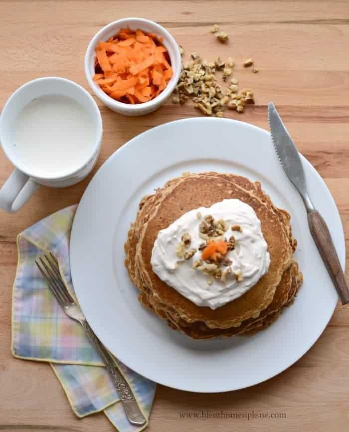 Whole Grain Carrot Cake Pancakes with Maple Cream Cheese Whipped Cream (naturally sweetened too!)