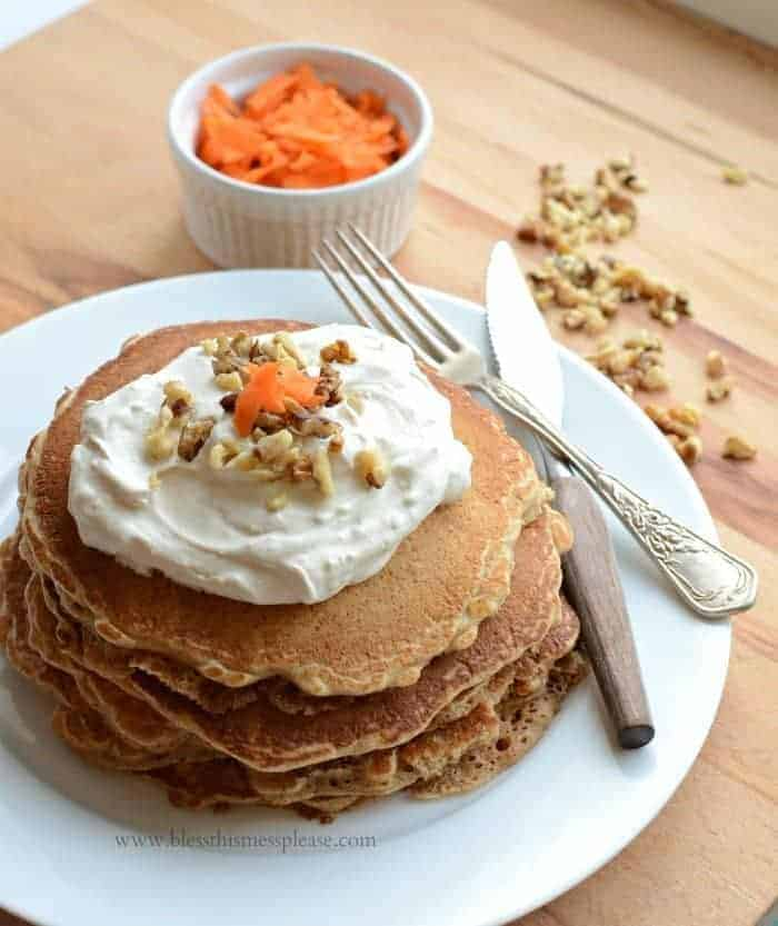 Whole grain carrot cake pancakes are full of spices and just the right amount of carrot. Top them with a simple maple sweetened cream cheese topping!