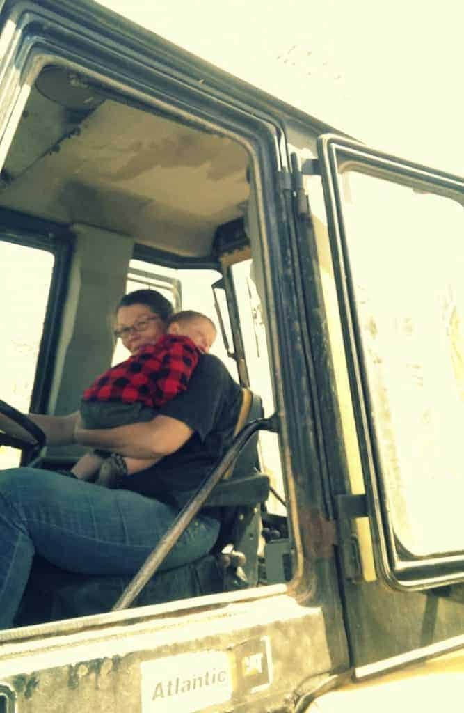 paul and mom in the backhoe