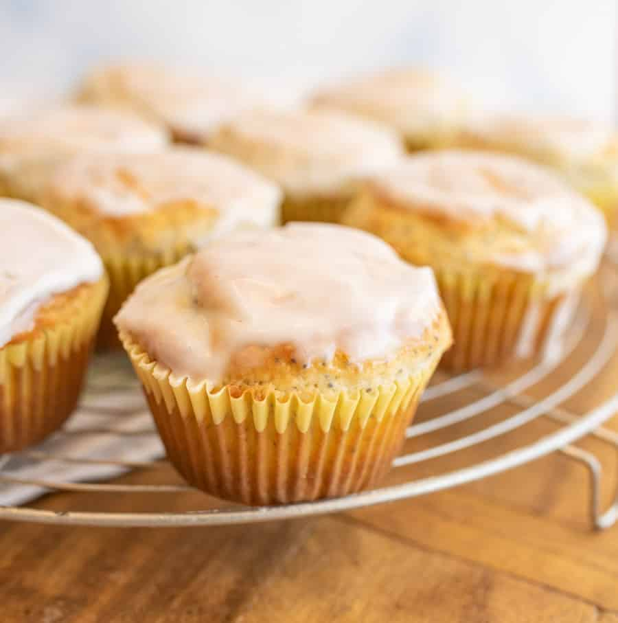close up picture of lemon poppy seed muffins on a rack