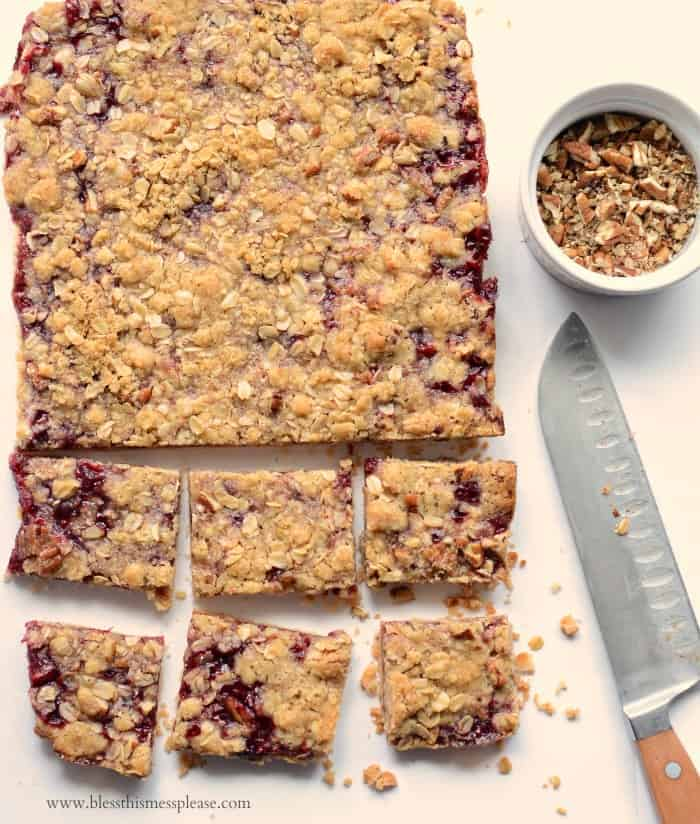 America's Test Kitchen's Raspberry Streusel Bars being cut into squares