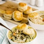 bowls of chicken pot pie with biscuits