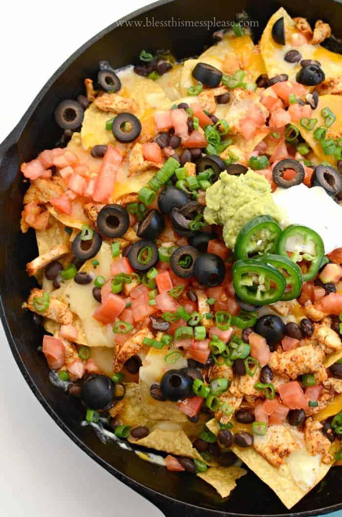 Easy Chicken Skillet Nachos Recipe in a cast iron pan