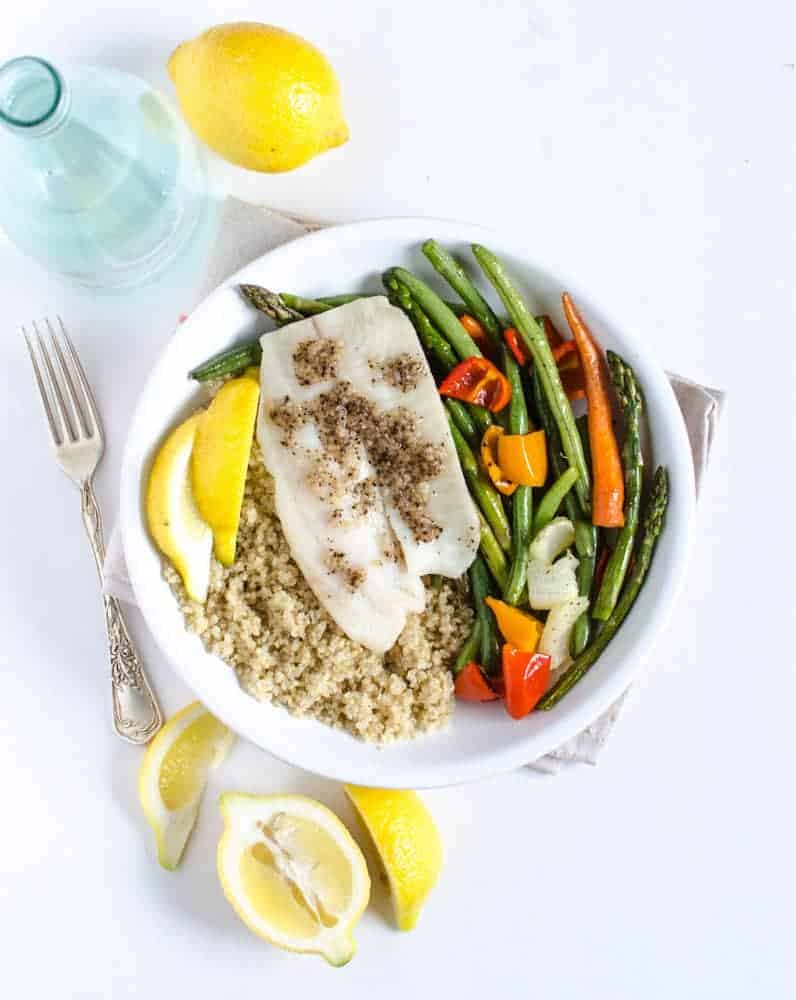 The easiest healthy meal around, simple oven roasted tilapia with vegetables that you can serve over rice or quinoa with a squeeze of fresh lemon.