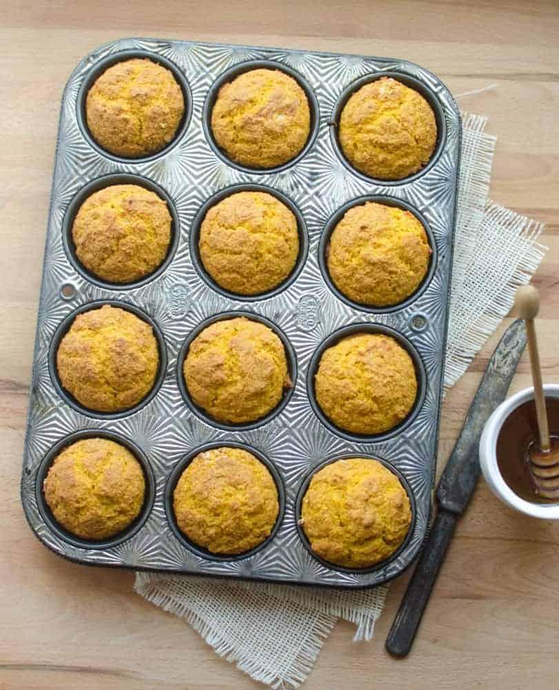 Image of Pumpkin Cornbread Muffins in a Muffin Tin