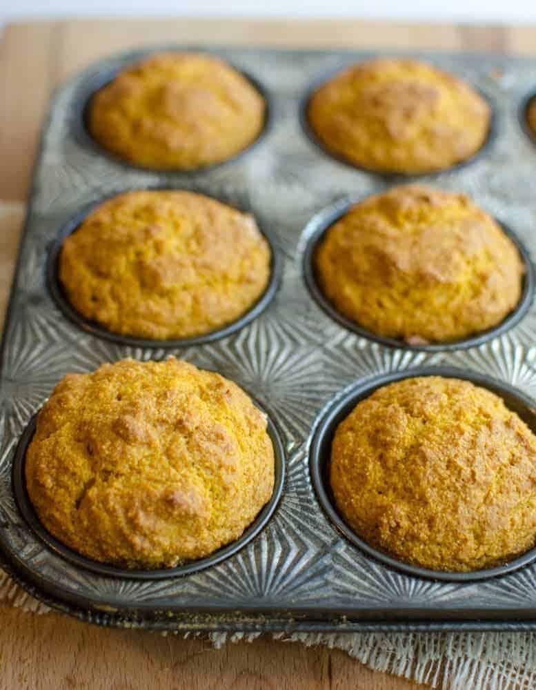 Image of Fluffy Pumpkin Cornbread Muffins in a Muffin Tin