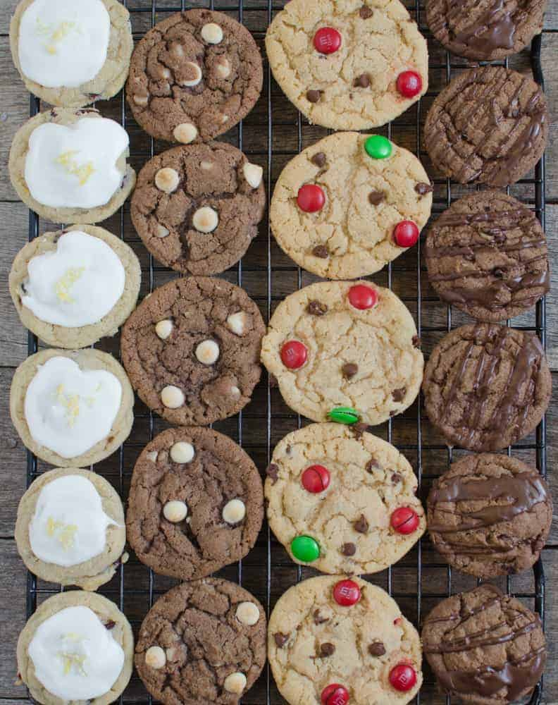 four types of cookies on a wire cooling rack