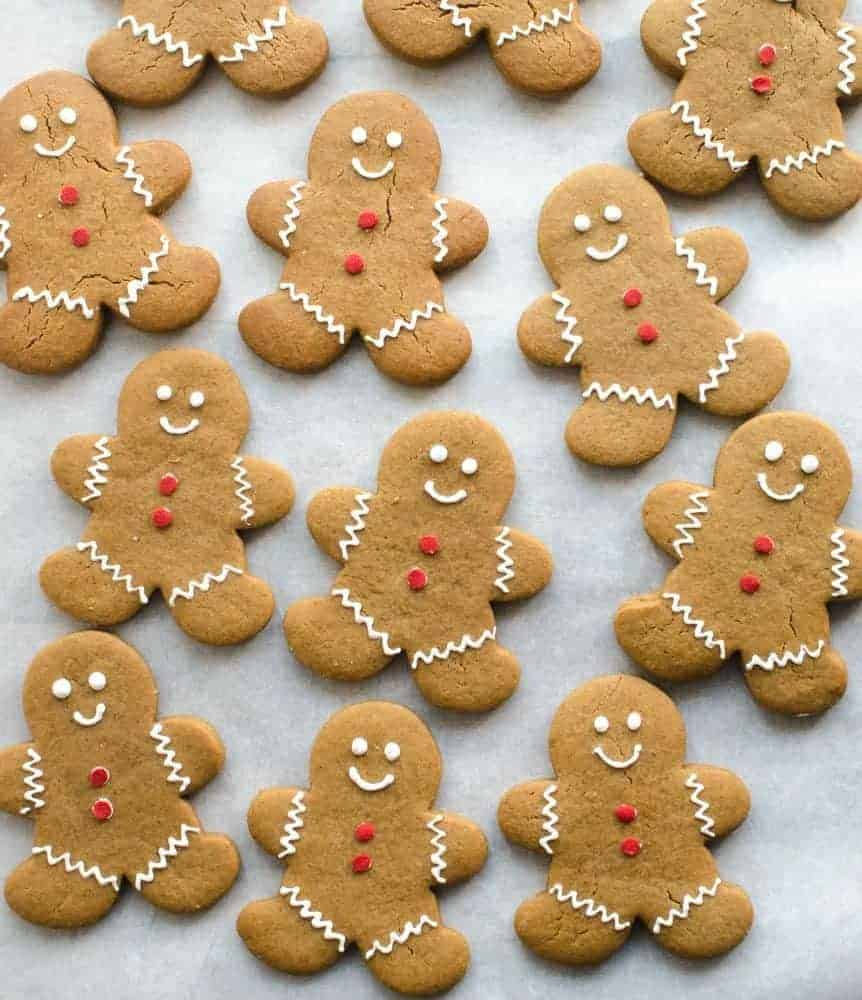 classic gingerbread man cookies decorated with smiles and red buttons