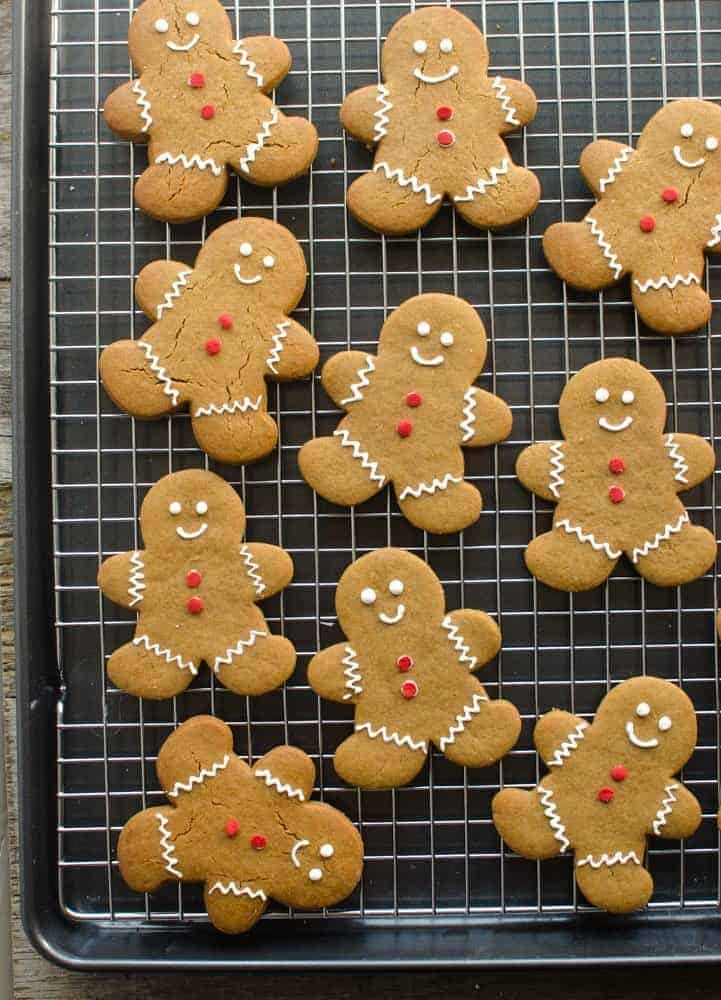 gingerbread cookie recipe baked and cooking on a rack, cut like gingerbread men