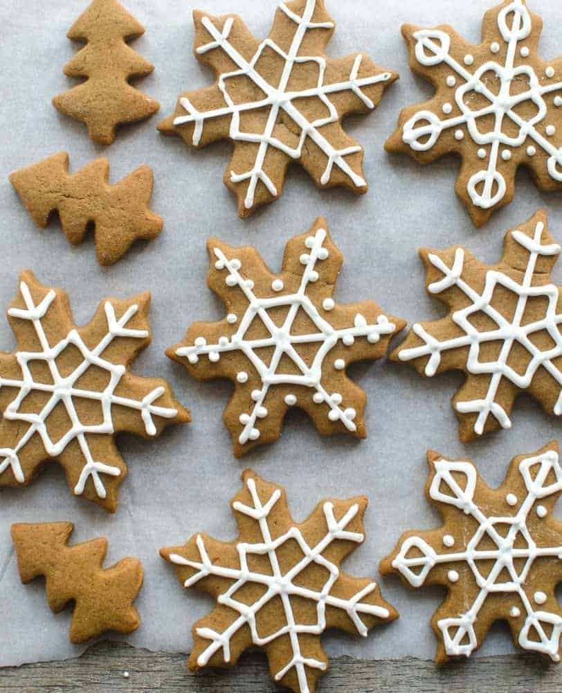 gingerbread snowflakes decorated with white icing