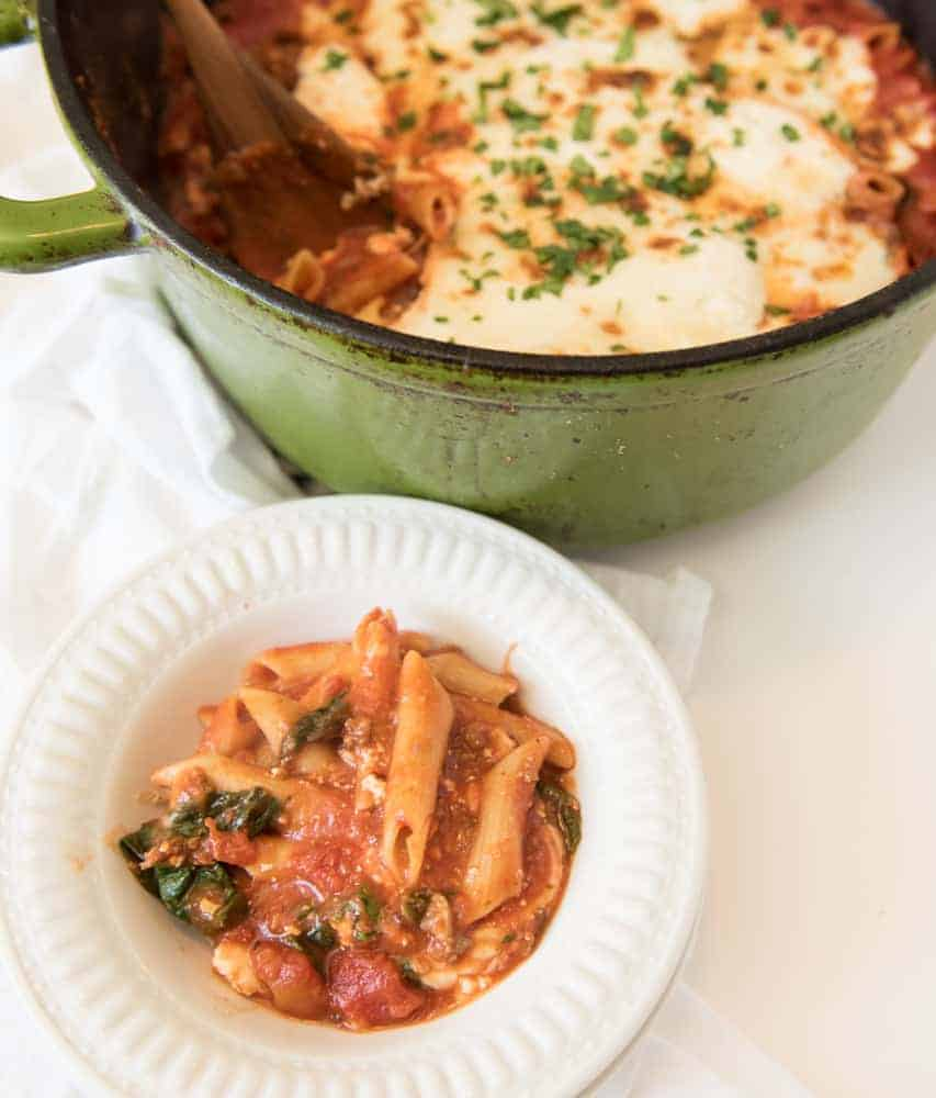 The best cheesy One Pot Baked Ziti recipe with sausage and spinach; everything, including the noodles are cooked in one pot and then finished in the oven.