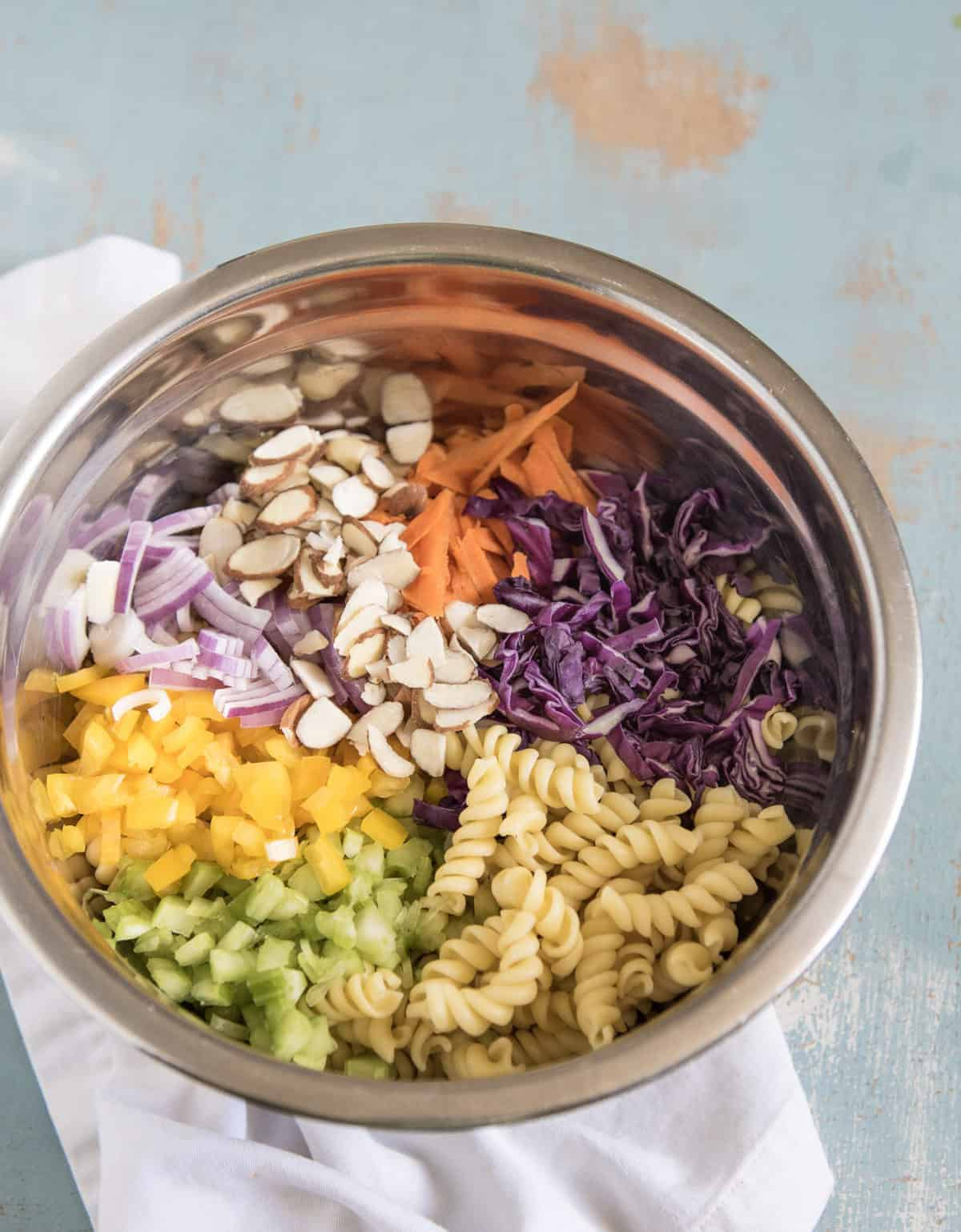 Asian Pasta Salad is made with chopped vegetables, pasta, a simple soy sauce dressing and it only takes about 20 minutes to make!