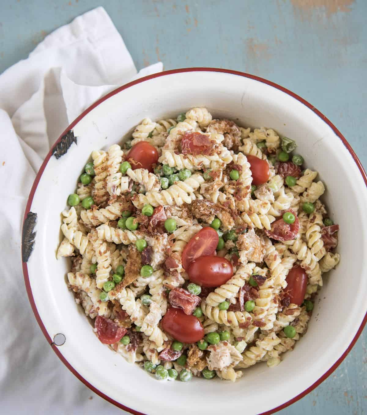 Chicken Bacon Ranch Pasta Salad is our favorite pasta salad recipe that comes together in about 20 minutes and the whole family loves it.