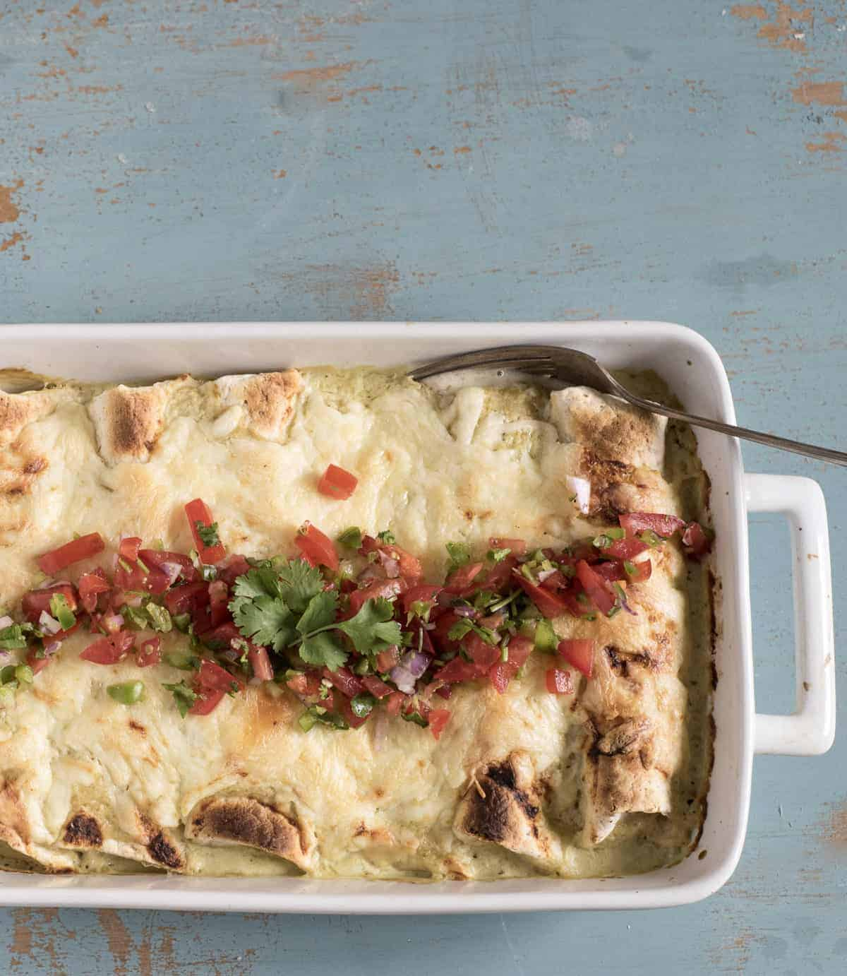 You're only 7 ingredients away from the best easy chicken enchiladas on the block! Simple, family-friendly chicken dinners are always a hit in this house and this one couldn't be more simple to get on the table.