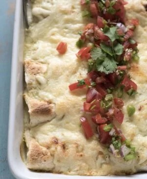 These chicken enchiladas are simple, family-friendly and only 7 ingredients!