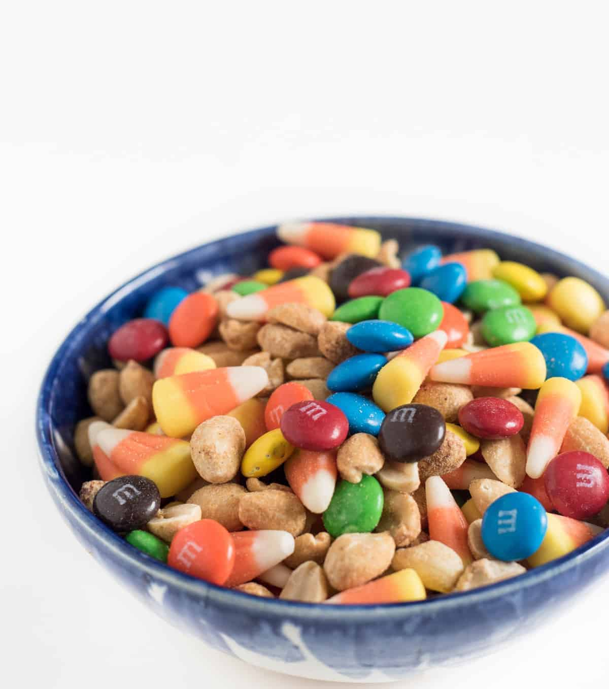 Candy corn snack mix is super simple to toss together but the flavor combination is unlike anything you've tasted!