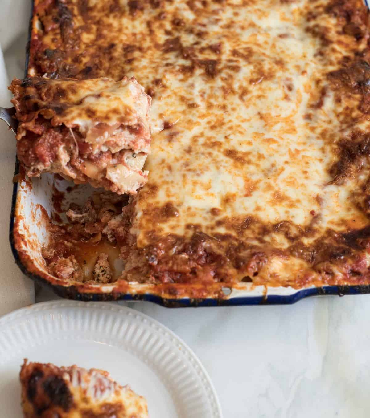 The Best Make-Ahead Lasagna recipe that is also freezer friendly is made with a rich sausage sauce and loads of cheese. This will be your go-to lasagna recipe guaranteed!