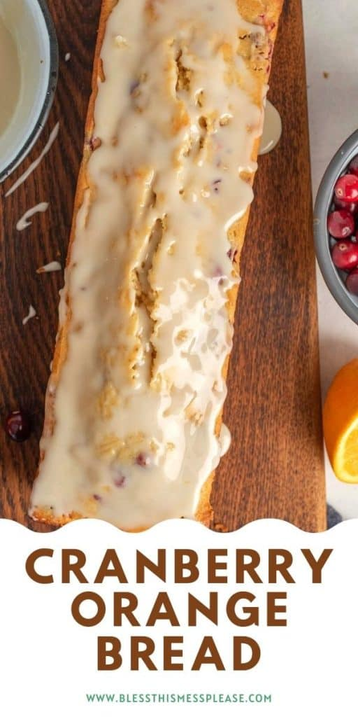 top view of a loaf of cranberry orange bread with glaze on top with the words cranberry orange bread below
