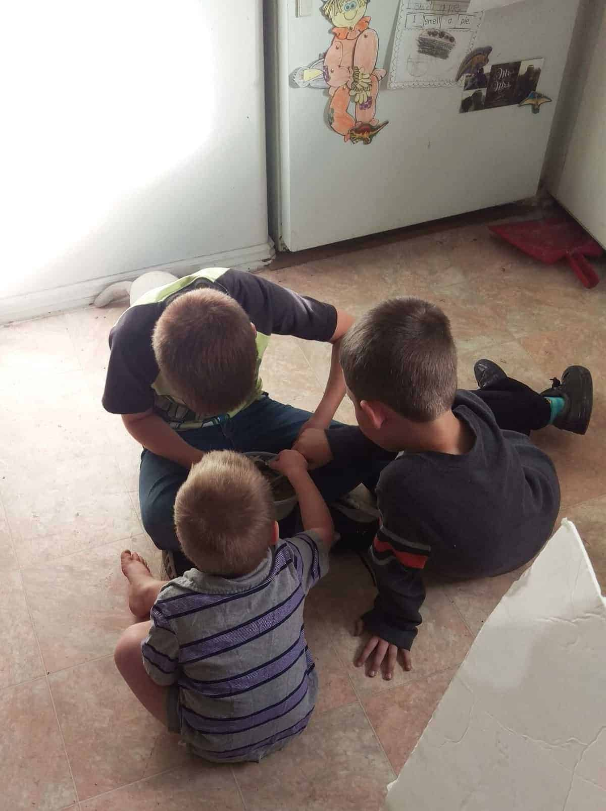 kids playing on the kitchen floor