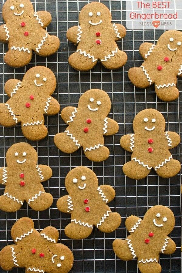 golden brown molasses gingerbread men cookies on black tray
