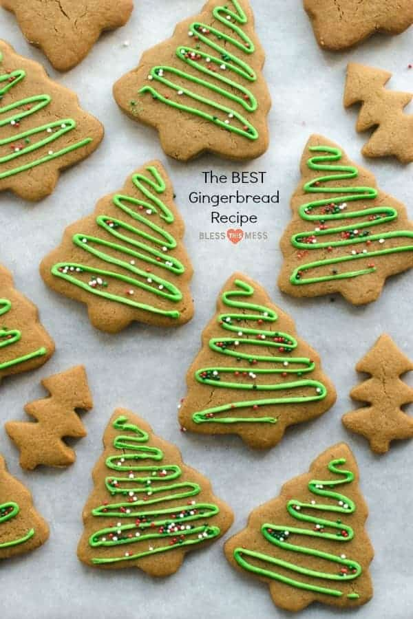 christmas tree shaped cookies with green icing and sprinkles on white